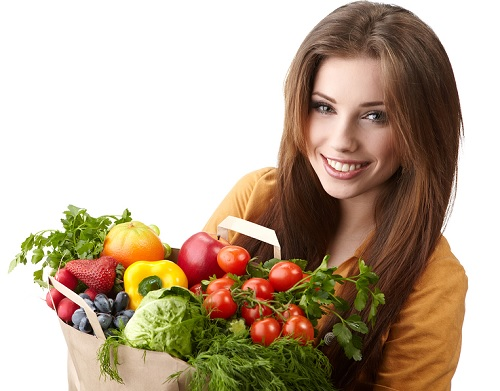 woman-holding-bag-of-fruit-veg